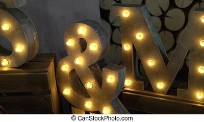 S M letters with lamp