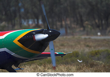 SA Flag - A prop plane with the nose painted in the colors...