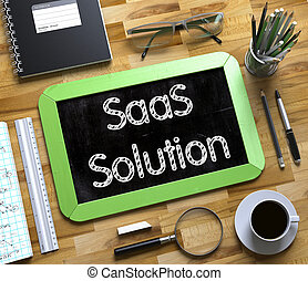 SaaS Solution Concept on Small Chalkboard. 3d. - SaaS...
