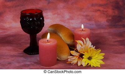 Sabbath image. challah bread, candelas on wooden table....