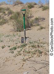 sabbia, pala, bastone