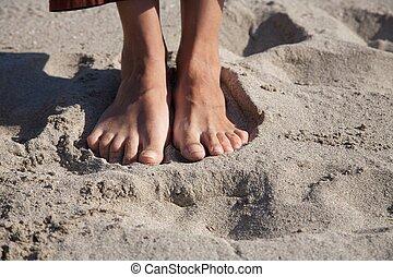 sable, pieds nue