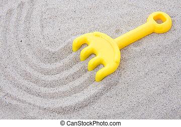 sable, râteau, plastique