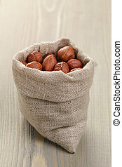 sack bag full of hazelnut kernels, rustic style photo