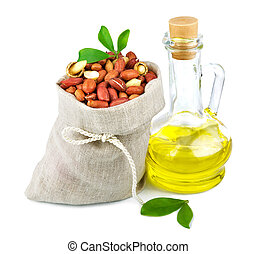 Sack of peanut and glass bottle of oil with leaves - Macro ...