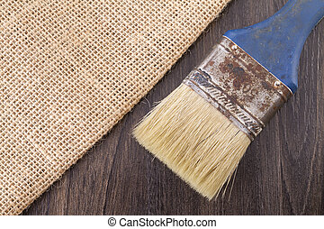 sackcloth and old brush on the wooden table