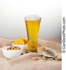 Sackcloth, glass of beer, pistachio, salty fish