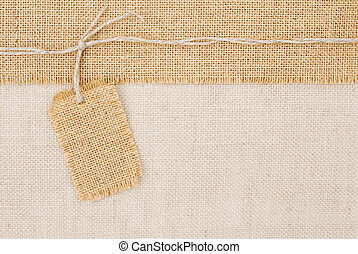 Sackcloth tag pricing over burlap texture