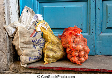 Sacks of potatoes and onions