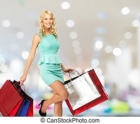 sacolas, shopping mulher, jovem, loura, sorrindo, loja roupa