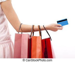 sacolas, shopping mulher, mão, crédito, segurando, cartão