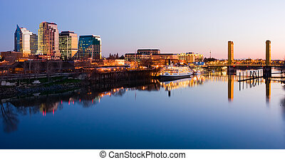 Sacramento skyline at night with reflection in the river
