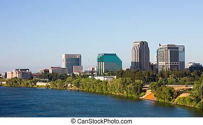 Skyscrapers next to a river in Sacramento