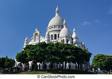 The Sacre Coeur - famous cathedral and popular touristic place in Paris, France