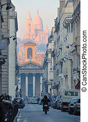 Sacre Coeur (Sacred Heart) Cathedral viewed from downtown Paris street.