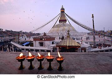 sacred candles in front of Boudha Nath (Bodhnath) stupa in kathmandu, Nepal