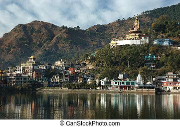 Sacred Rewalsar lake with big golden statue of Padmasambhava