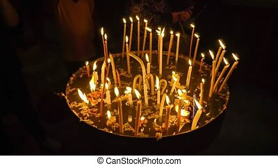 Sacrificial candles in the church - Sacrificial candles in...