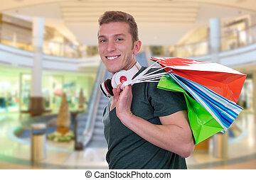 sacs, achats, jeune, centre commercial, désinvolte, homme