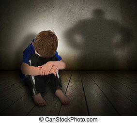 Sad Abused Boy with Anger Shadow - A young boy is sitting on...