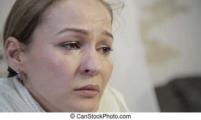 Sad abused woman with brown eyes crying, parting with your...