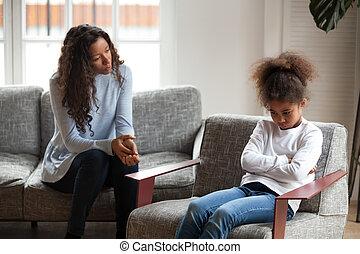 Sad African American girl avoid talking to mom