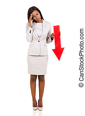 african businesswoman holding red arrow