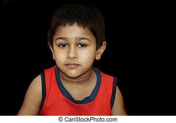 Sad - An handsome Indian kid looking very gloomy and sad