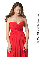 Sad and beautiful girl in red dress on isolated