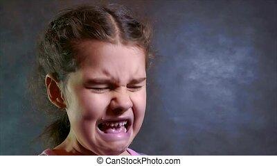 sad and depressed lifestyle little girl worth crying on white background. slow motion video. little sad girl flow tears. teen girl sad depression concept