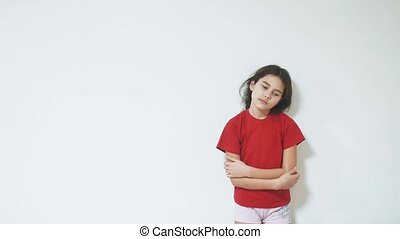 sad and depressed little girl standing by the wall. girl...