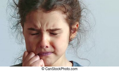 sad and depressed little girl worth crying on a white background. little sad girl flow tears. teen girl sad depression lifestyle concept