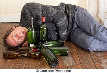 sad and drunk man - drunk man lying on floor with empty...
