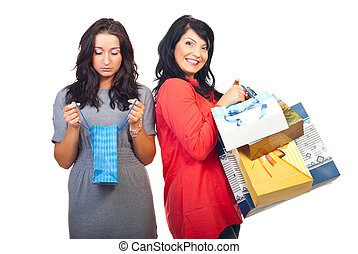 Sad and happy women at shopping - Sad woman holding and...