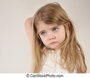 Sad and Tired Little Child - A little child looks sad and...