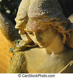 sad angel (antique statue) - angel in the sunlight (antique...