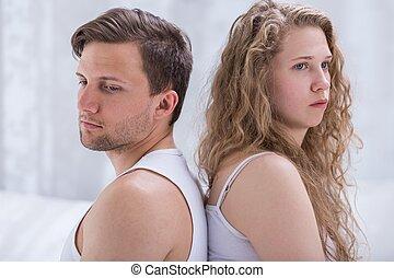 Sad arguing couple