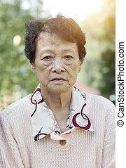 Sad Asian elderly woman
