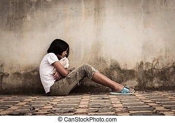 sad asian girl alone with white bear near old wall cement, ...