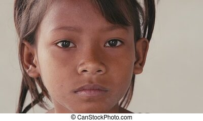 Portrait of real Asian people, with emotions and feelings, looking at camera. Sad child from Cambodia, Southeast Asia. 28of62
