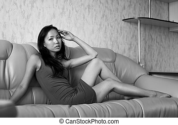 Sad asian woman on sofa