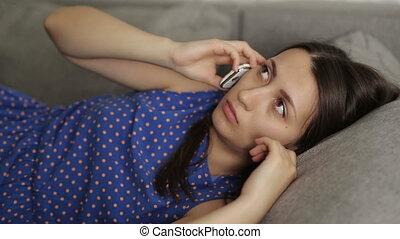 Sad Attractive Woman Speaks on the Phone - sad woman speaks...