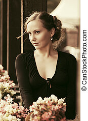 Sad beautiful fashion woman in black dress