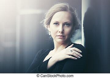 Sad beautiful fashion woman on night city street