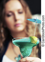 Sad beautiful woman with cocktail