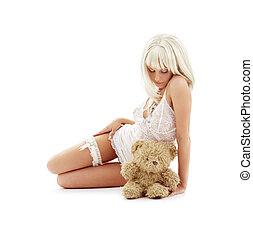 sad blond with teddy bear