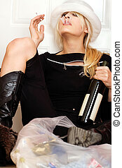Sad blond woman with cigarette and botle of wine