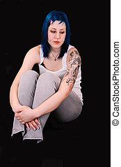 Sad blue haired girl.