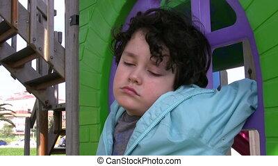 Sad boy crying in the playground