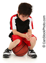 Sad Boy Lost Basketball Game - Sad elementary school boy...